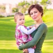Stock Photo: Baby girl with mom in the park