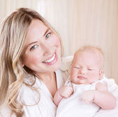 Happy mommy with baby — Stock Photo