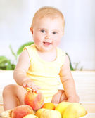 Cute baby with fruits — Stock Photo