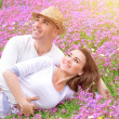 Loving couple on the floral field — Stock Photo