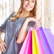 Cheerful girl with shopping bags — Stock Photo