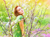 Seductive woman in the garden — Stock Photo