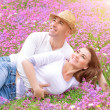 Loving couple on the field — Stock Photo