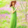 Beautiful woman in spring park — Stock Photo