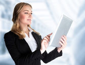 Business lady with touch pad — 图库照片