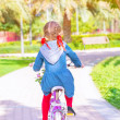 Little girl on the bicycle — Stock Photo