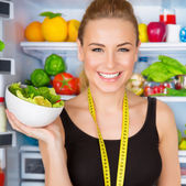 Dietitian with fresh salad — Stok fotoğraf