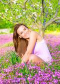 Female on springtime backyard — Stock Photo