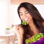 Cute girl eating salad — Stock Photo #44852863