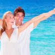 Happy couple playing on the beach — Stock Photo #44852935