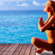 Woman meditating on the beach — Stock Photo #44853619