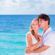 Loving couple on the beach — Stock Photo #45302573