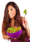 Sportive girl eating fresh salad — Stock Photo