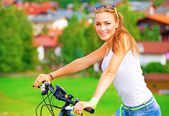 Happy woman on bicycle — Stock Photo