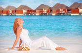 Girl taking sunbath on the beach — Stock Photo