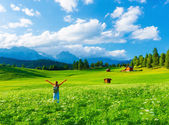 Happy traveler in mountainous valley — Stock Photo