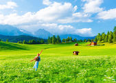 Happy traveler girl in mountainous valley — Stock Photo