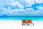 Two empty sunbed on the beach — Stock Photo