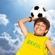 Cute boy playing football — Stock Photo #47637121