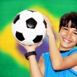 Cute boy playing football — Stock Photo #47637181