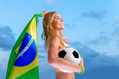 Happy fan of Brazilian football team — Stock Photo