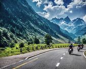 Motorcyclists on mountainous road — Stock Photo
