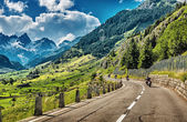Group of bikers touring European Alps  — Stock Photo