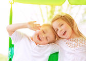 Adorable children on swing  — Stock Photo