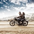 Постер, плакат: Active couple on the motobike