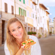 Happy woman eating pizza — Stock Photo