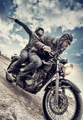 Active couple on motorcycle — Stockfoto