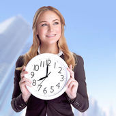 Happy businesswoman with big clock — Stock Photo