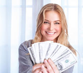 Happy woman with lot of money — Stock Photo
