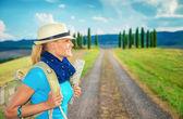 Cute female trekking along Europe — Stock Photo