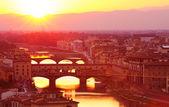 Ancient Italian bridge in sunset light — Stock Photo