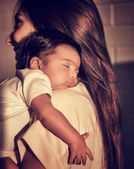 Mother with sleeping baby — Stock Photo
