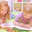Happy baby boy & girl enjoying homework — Stock Photo #51790767