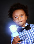 Little genius with illuminated lamp — Stock Photo
