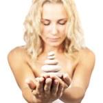 Zen spa stones in women hands — Stock Photo #7297538