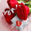 Beautiful roses with gift box & heart — Stock Photo #8247684