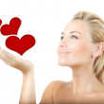 Beautiful woman holding hearts — Stock Photo #8601429