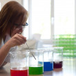 Female college student experimenting in a laboratory — Stock Photo #40972845
