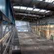 Old crane in a deserted hall — Stock Photo