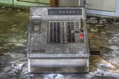 Old cash register in an abandoned market — Stock Photo