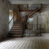 Old staircase in an abandoned building — Stock Photo