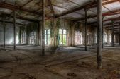 Old abandoned hall with rails — Stock Photo