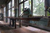 Old iron in abandoned laundry — Stock Photo