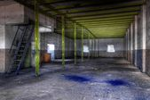 Old and abandoned paint factory — Stock Photo