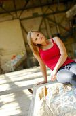 Young woman in dilapidated warehouse — Stockfoto