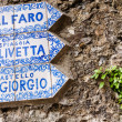 Signposts shows the way to the tourist attractions in Portofino - Stockfoto